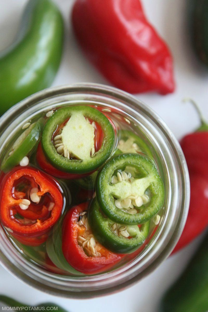Close up view of jalapenos fermenting in a mason jar