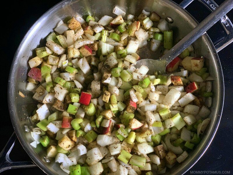 Gluten-free stuffing ingredients cooking in large skillet