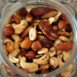 Jar full of mixed nuts that have soaked and dehydrated
