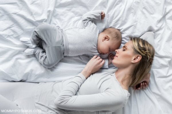 Mom and baby co-sleeping in bed