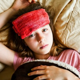 girl with a wet rag on her forehead