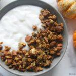 Pumpkin spice granola in bowl with yogurt