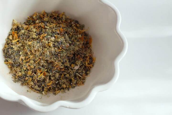 This postpartum herbal sitz bath recipe helps new moms heal and relax by soothing soreness and preventing infection.
