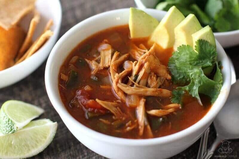 Chicken Tortilla Soup Recipe - poblano peppers, fresh cilantro, tangy lime and warm spices come together to make this belly warming soup a favorite in our house