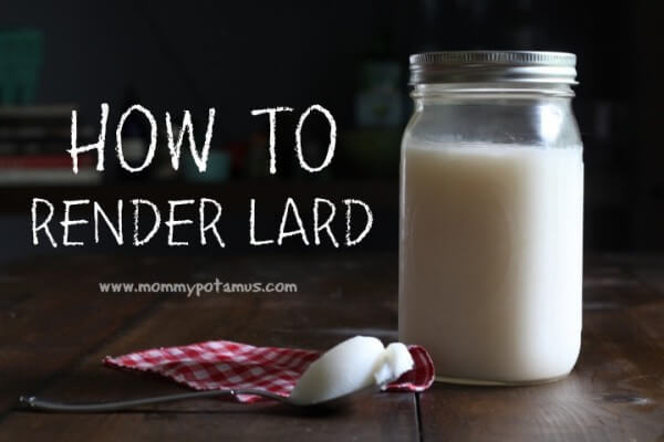 jar of rendered lard next to a spoon