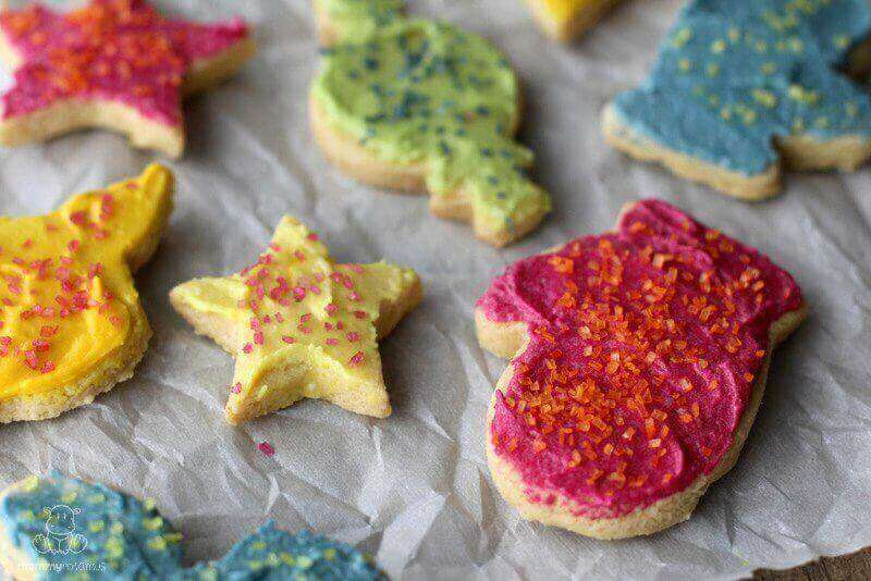 Gluten-free sugar cookies on parchment paper and baking sheet