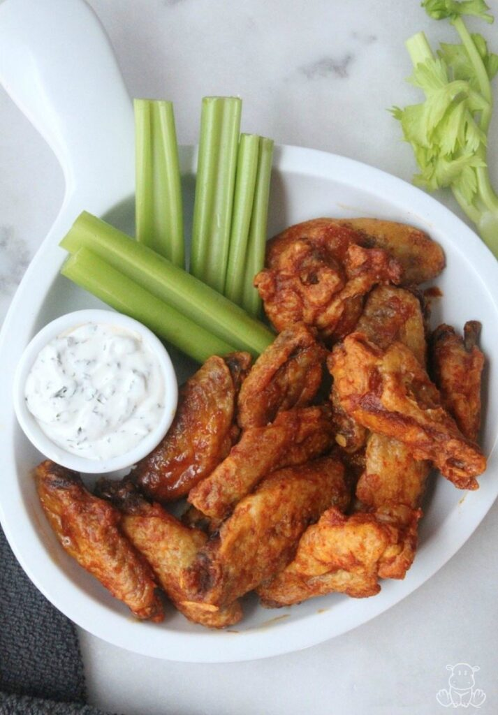 Baked buffalo wings on table