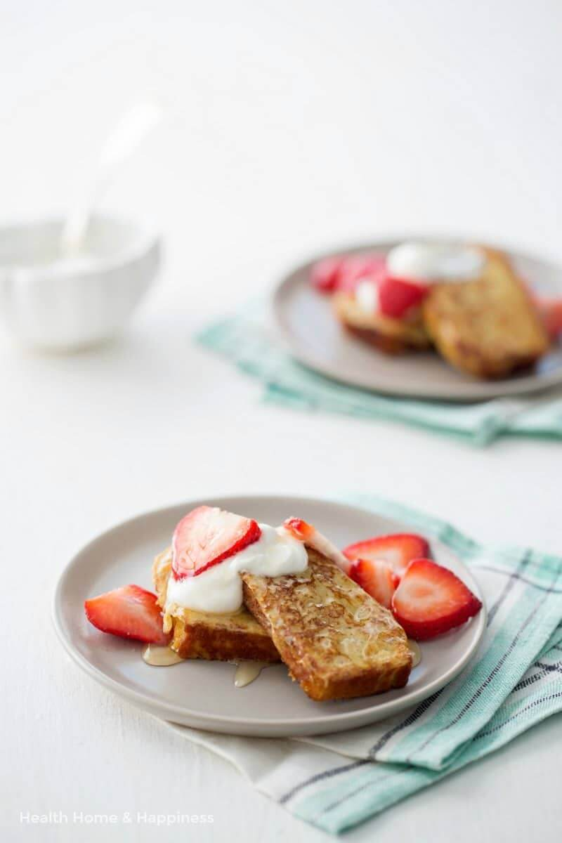 Made with day-old coconut flour bread, this gluten-free French toast recipe is a delightful morning treat! Top with strawberries, maple syrup, honey, toasted pecans, or whatever your family likes best.