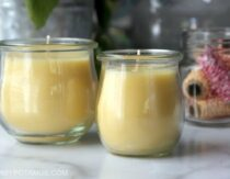 two homemade beeswax candles on a counter