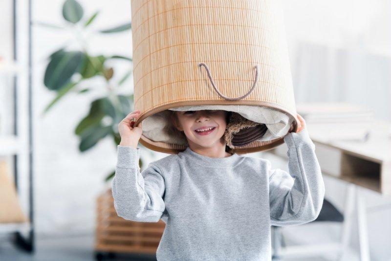 Child holding laundry basket