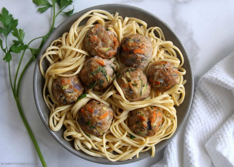 Ovenb-baked turkey meatballs over a bowl of pasta