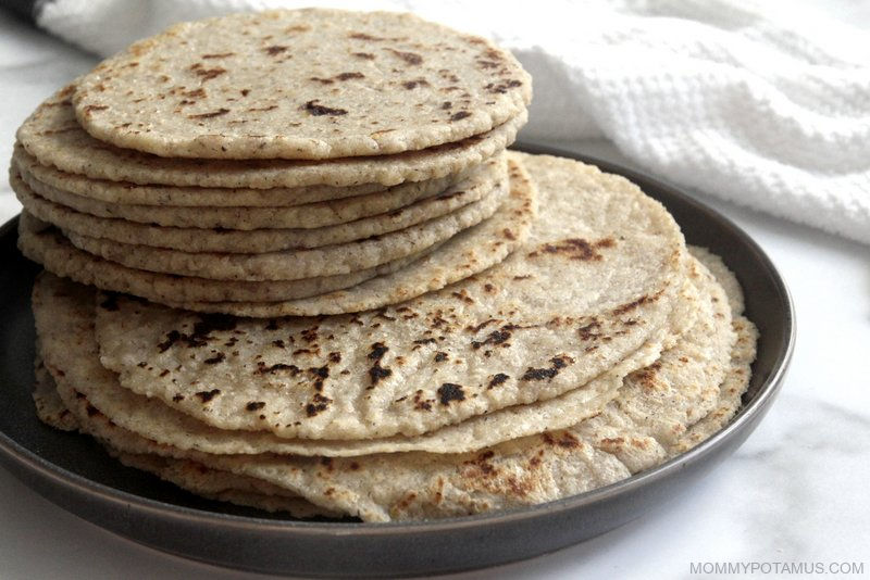 Stack of gluten-free tortillas in two sizes: Small, thick ones and large, thin ones.