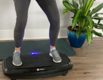woman standing on top of vibration plate