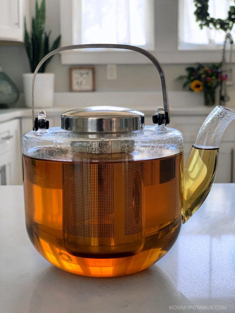 Lemon balm tea in glass teapot