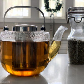 Dried catnip in jar next to honey and catnip tea