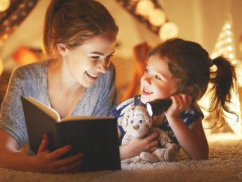 Mom and daughter reading. Storytime family tradition.
