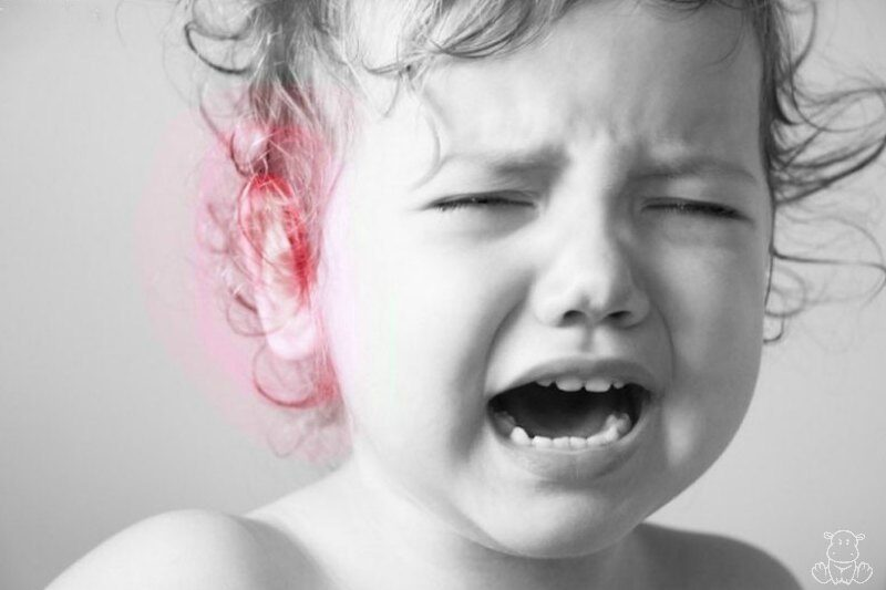 Child in pain with earache or ear infection