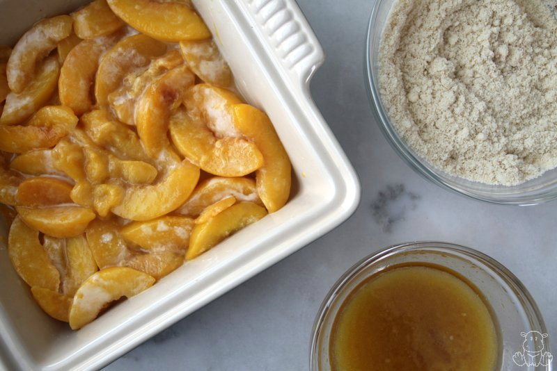 Peach filling mixture with topping ingredients ready to be mixed together