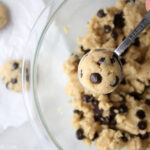 Scooping paleo chocolate chip cookie dough out of a bowl