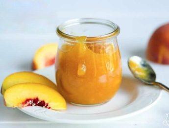 Peach freezer jam in a glass jar